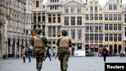 Belgian soldiers patrol in the Grand Place of Brussels following Tuesday's bombings in Brussels, Belgium, March 24, 2016.