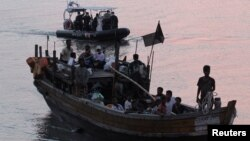 Rohingya refugees, who were intercepted by Malaysian Maritime Enforcement Agency off Langkawi island, are escorted in their boat as they are handed over to immigration authorities, at the Kuala Kedah ferry jetty in Malaysia, April 3, 2018. On Friday, five Rohingya were rescued off the coast of Sumatra.