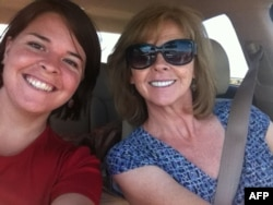 FILE - This undated handout photo shows 26-year-old Kayla Mueller(L) and her mother Marsha Mueller.