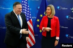 FILE - U.S. Secretary of State Mike Pompeo poses with EU Foreign Policy chief Federica Mogherini ahead of a meeting in Brussels, Belgium, July 12, 2018.