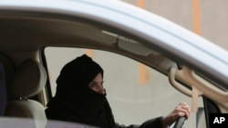 In this file photo, Aziza Yousef drives a car on a highway in Riyadh, Saudi Arabia, as part of a campaign to defy the country's ban on women driving.