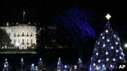 The National Christmas Tree is pictured with the White House in the background after it was lit on the Ellipse across from the White House in Washington.
