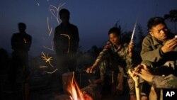 Phiến quân Kachin tại khu vực núi Tsinyu ở bắc Miến Ðiện.