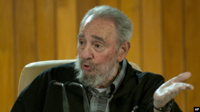 Former Cuban leader Fidel Castro speaks during a meeting with Cuban and foreign intellectuals visiting Havana's international book fair February 15, 2011.