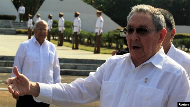 Cuba's President Raul Castro talks to the media after a wreath-laying ceremony at the Soviet Soldier monument in Havana, February 22, 2013.