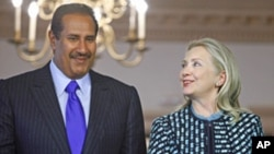 Secretary of State Hillary Rodham Clinton and Qatari Prime Minister Sheikh Hamad bin Jassim bin Jabor Al Thani at the State Department in Washington, Jan. 11, 2012.