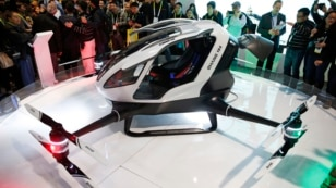 FILE - The EHang 184 autonomous aerial vehicle is unveiled at the EHang booth at CES International in Las Vegas, Jan. 6, 2016. The drone is large enough to fit a human passenger.