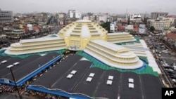 """An elegant dome is seen atop French style Centeral Market """"Phsar Thom Thmei"""" as it reopens Wednesday, May 25, 2011, in Phnom Penh, Cambodia, after seven years of renovations. Central Market is a large market constructed in 1937 in the shape of a dome wit"""