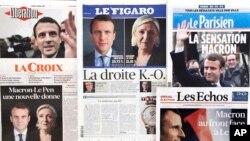 ក្របមុខនៃកាសែតបារាំងរាយការណ៏ពីបេក្ខជនប្រធានាធិបតីនាំមុខក្នុងការបោះឆ្នោតជុំទី១របស់ប្រទេសបារាំងរវាងបេក្ខជនគណបក្សនិយមកណ្តាលលោក Emmanuel Macron និងមេដឹកនាំស្តាំនិយមអ្នកស្រី Marine Le Pen កាលពីថ្ងៃទី២៤ មេសា ២០១៧។