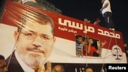 A picture of Egypt's President Mohamed Morsi on a vehicle in Tahrir Square, Cairo, July 10, 2012.