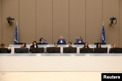 FILE - Presiding Judge Robert Fremr is pictured in the courtroom during the trial of Congolese warlord Bosco Ntaganda at the ICC (International Criminal Court) in the Hague, the Netherlands, Aug. 28, 2018.