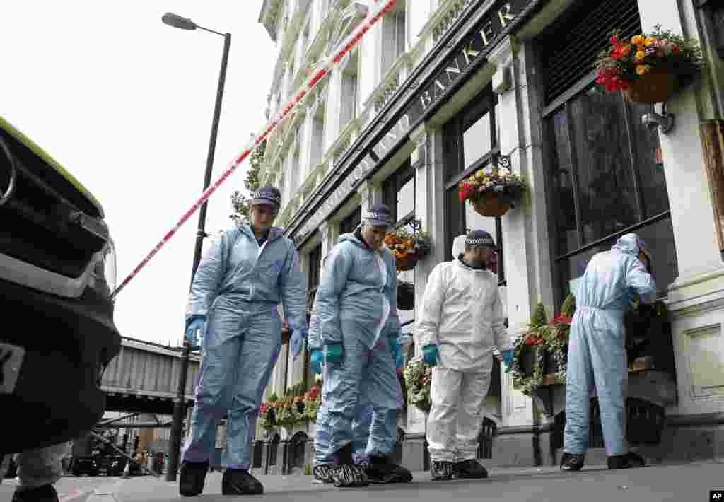 Forensic police investigate around the Borough Market and London Bridge area of London, June 5, 2017.