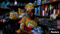 hade Ajayi, 50, shops for thread for her bag-making business, at a store in Ilorin, Kwara state, March, 26, 2021. REUTERS/Temilade Adelaja