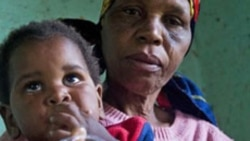 A child with HIV is given medication by a care-giver in Durban, South Africa.