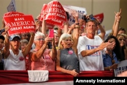 Supporters cheer as Republican presidential candidate Donald Trump arrives to speak at a campaign rally in Fredericksburg, Va., Aug. 20, 2016.