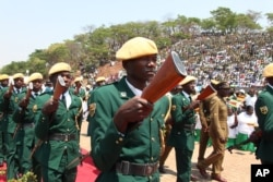 Zimbabwean soldiers march as Zimbabwean President Robert Mugabe arrive for the state burial of a former foreign minister Stan Mudenge, officiated by Zimbabwe President Robert Mugabe, in Harare, Monday, Oct. 8, 2012.