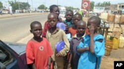 A group of child beggars stand in the streets of Kano, Nigeria on 17 Nov 2009
