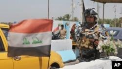 Iračka policija na kontrolnom punktu u Bagdadu, 22. juni,2014.