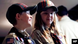 In a Thursday, March 1, 2018 photo, Ian Weir, left, smiles as he stands with his twin sister Tatum after a cub scout meeting in Madbury, N.H. (AP Photo/Charles Krupa)