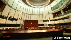 Hong Kong's legislature rejected the Beijng-supported plan for electing the city's chief executive.