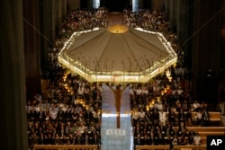 FILE - Politicians and other dignitaries attend a solemn Mass at Barcelona's Sagrada Familia Basilica for the victims of the terror attacks that killed 14 people and wounded over 120 in Barcelona, Spain, Aug. 20, 2017.