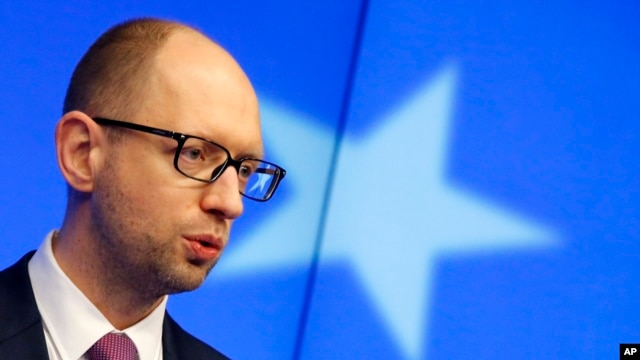 FILE - Ukraine's interim Prime Minister Arseniy Yatsenyuk speaks during a press conference in Brussels on March 6, 2014.