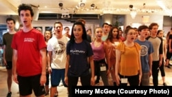 Jasmine Rogers, center, and the other contestants rehearse their opening number.