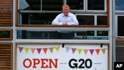 Pub owner Richard Deery awaits customers from the G-20 conference in Brisbane, Australia, Nov. 13, 2014.