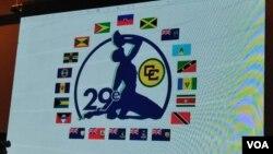 Foto ki montre drapo peyi manm Caricom yo ak senbòl Nèg Mawon Ayiti a. Foto: Jounalis Sèvis Krey