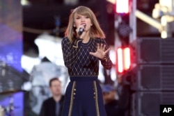"Taylor Swift performs on ABC's ""Good Morning America"" in Times Square, Oct. 30, 2014, in New York."