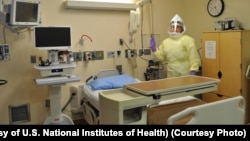 FILE - Workers must wear protective gear to care for patients with Ebola or other infectious disease in the NIH Clinical Center's high containment unit. (Photo courtesy of the U.S. National Institutes of Health)