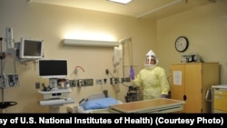 Workers must wear protective gear to care for patients with Ebola or other infectious disease in the NIH Clinical Center's high containment unit. (Photo courtesy of the U.S. National Institutes of Health)