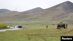 Kyrgyz and Uzbek troops are seen in a disputed area near the town of Kerben, Kyrgyzstan, March 25, 2016.