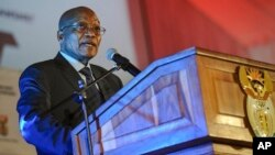 """FILE - South African President Jacob Zuma speaks at the official launch of the Trans-Africa Locomotive prototype near Pretoria, South Africa, April 4, 2017. On Tuesday, Zuma launched a new Metrorail system dubbbed """"People's Trains."""""""