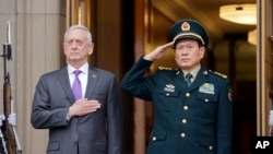 U.S. Defense Secretary Jim Mattis and Chinese Minister of Defense Gen. Wei Fenghe stand as the national anthems are played during a welcome ceremony at the Pentagon, Nov. 9, 2018.