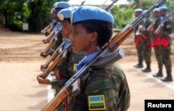 FILE - Rwandan peacekeepers from the Rwanda Defense Force (RDF) parade after arriving in Juba, South Sudan, Aug. 8, 2017.