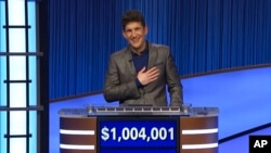"""This photo provided by Jeopardy Productions Inc. shows """"Jeopardy!"""" contestant Matt Amodio after his total win amount was announced, Sept. 24, 2021."""