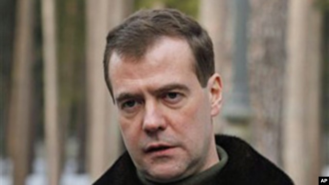 Russia's President Dmitry Medvedev speaks to the media at the Gorki residence outside Moscow, March 21, 2011