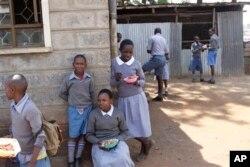 FILE - Pupils play during their lunch break at Mariakani Primary School in Nairobi, Kenya, July 27, 2015.