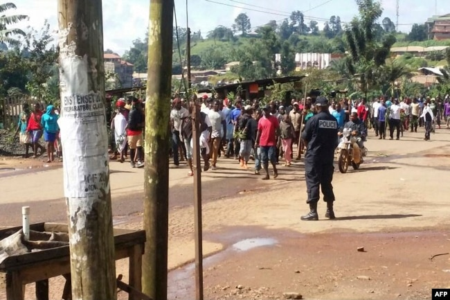 Demonstrators march during a protest against perceived discrimination in favour of the country's francophone majority, Sept. 22, 2017 in Bamenda, the main town in northwest Cameroon and an anglophone hub.
