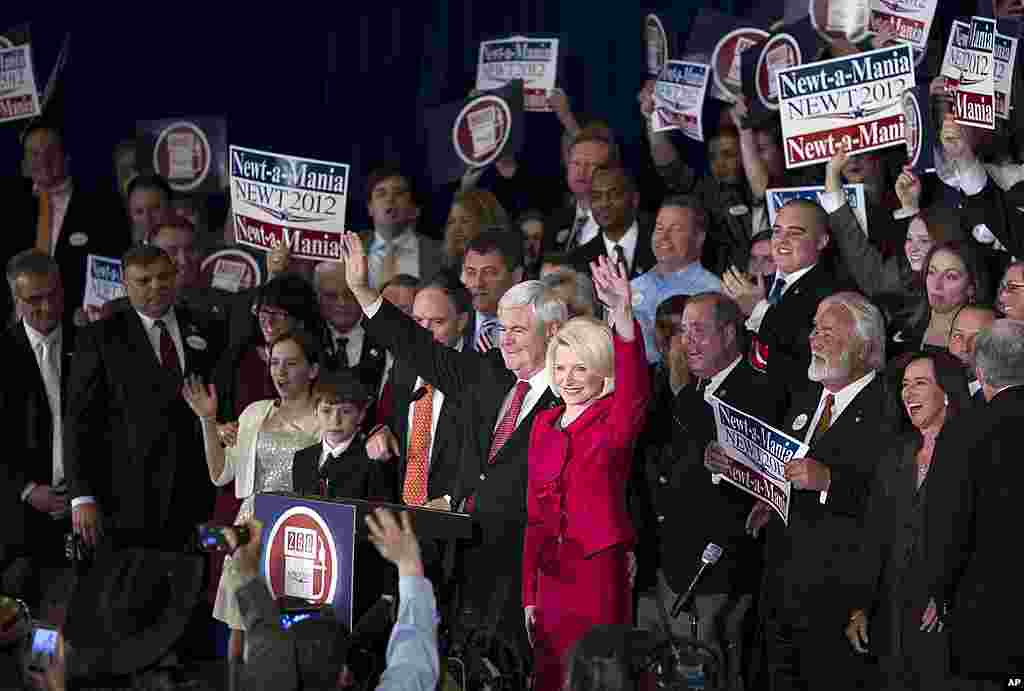 Republican presidential candidate Newt Gingrich, left, and his wife Callista wave as they arrive for a Super Tuesday rally in Atlanta, Georgia, March 6, 2012. (AP)