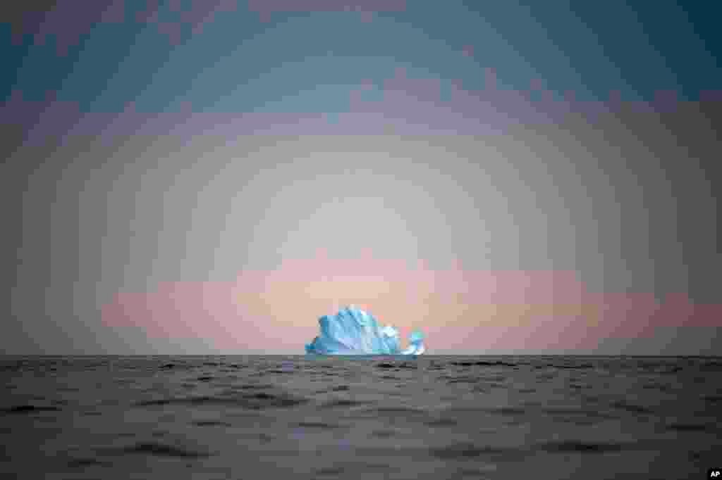 A large iceberg floats away near Kulusuk, Greenland, on Aug. 15, 2019. (AP Photo/Felipe Dana)