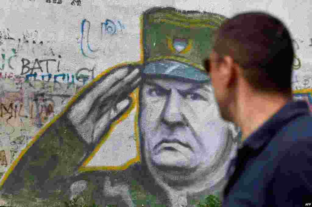 May 26: Graffiti of war crimes fugitive Bosnian Serb army commander Ratko Mladic seen in Belgrade, Serbia. Serbia's President Boris Tadic confirms war crimes fugitive Ratko Mladic has been arrested. (AP Photo)