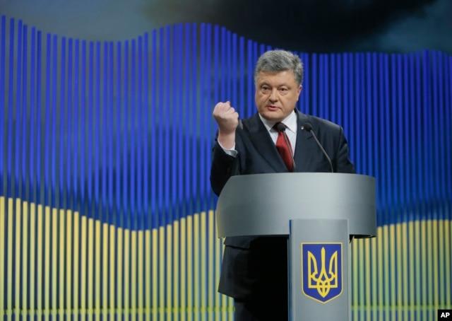 FILE - Ukrainian President Petro Poroshenko gestures while speaking during a news conference in Kyiv, Ukraine, Jan. 14, 2016.