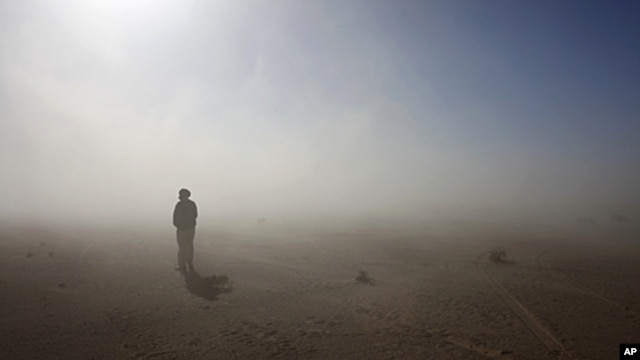 A Sahrawi man stands in the Sahara desert between Tindouf and Tifariti, February 26, 2011.