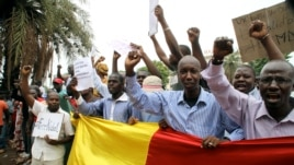 Malian people take part in a demonstration in front of the French Ambassy in Bamako on May 19, 2014, to denounce the occupation by rebels of Kidal, 1,500 kilometres (900 miles) northeast of the capital Bamako, and accuse France of complicity with armed gr