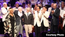 (From left) Jessye Norman, John Williams, Steven Spielberg, Yo-Yo Ma, Keith Lockhart and James Taylor celebrate the composer's 80th birthday onstage at Tanglewood, the summer home of the Boston Symphony Orchestra in western Massachusetts. (Hilary Scott)