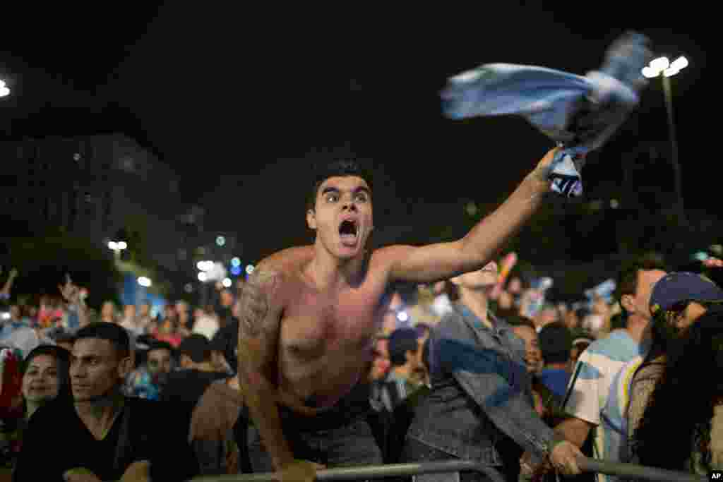 A fan of the Argentina national soccer team celebrates after his team defeated the Netherlands during a semifinals World Cup match, at the FIFA Fan Fest, in Sao Paulo, Brazil, July 9, 2014.