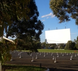 This drive-in theater is in Australia, but the photo gives you a good idea of how the speakers are lined up and waiting for cars and their occupants to arrive for the show.