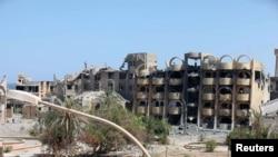 Des bâtiments endommagés à la suite d'une bataille avec les militants de l'Etat islamique à Syrte, le 7 septembre 2016. (Reuters/ Hani Amara)